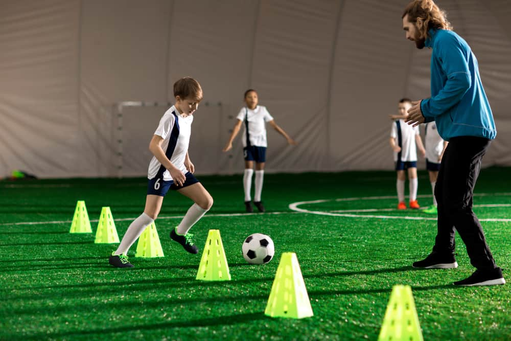 How do you become a soccer coach for kids