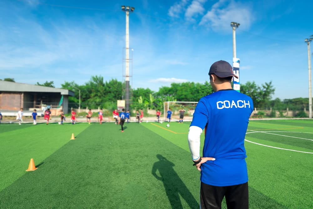 What is the role of a soccer coach